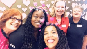 Four collier employees pose for a group Snapchat photograph.