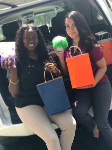 Collier employees showcasing promotional toiletries
