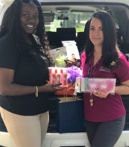 Collier employees shocasing promotional toiletries