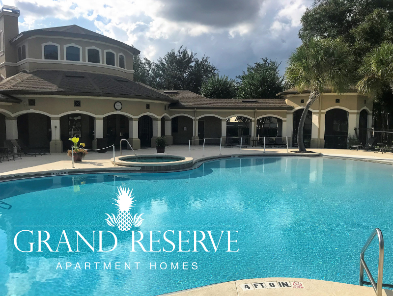 The pristine luxury pool located at The Grand Reserve high-end apartments.