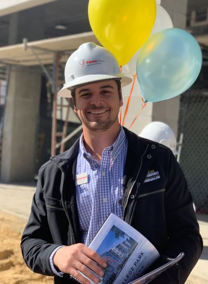 Collier employee visiting the construction of College Park at Midtown Luxury Apartments