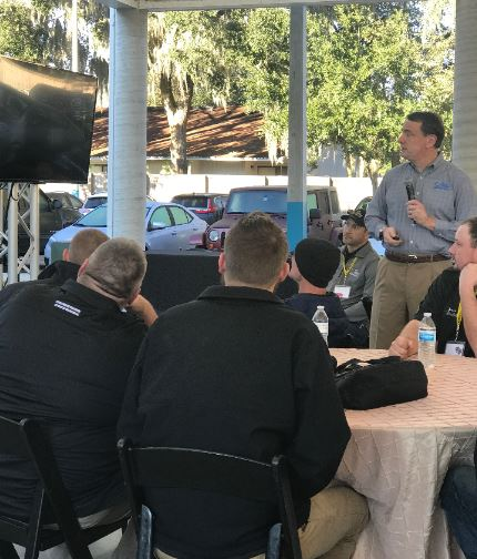 Collier employee leads an outdoor meeting