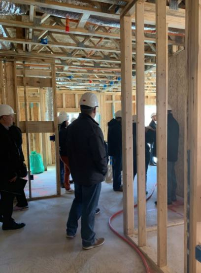 Collier employees touring a construction site