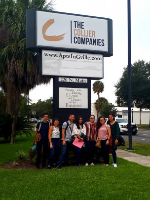 Students pose in front of the TCC HO Sign