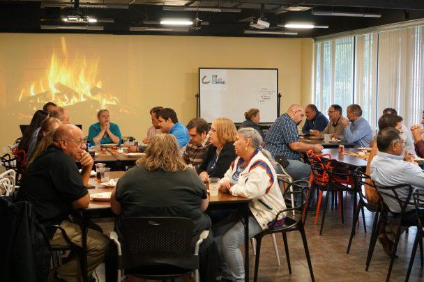 TCC Team Members enjoy a Thanksgiving potluck meal