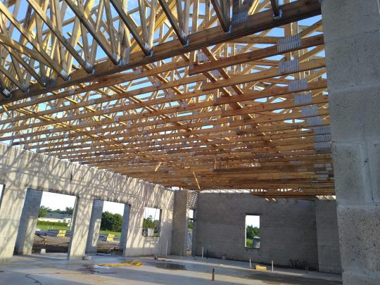 An open roof is shown with exposed trusses